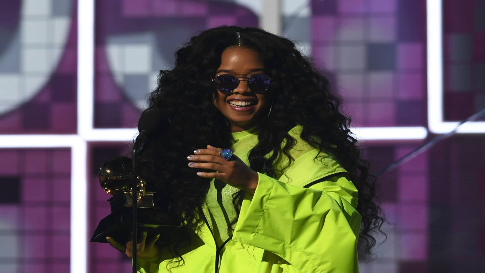 Watch Ella Mai Interrupt H.E.R. On The Grammy Red Carpet To Congratulate Her