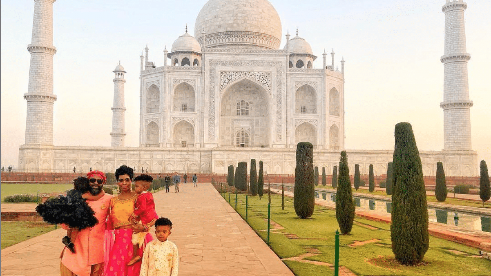 Black Travel Moment of the Day: We Love This Sweet Family Photo Opp At The Taj Mahal