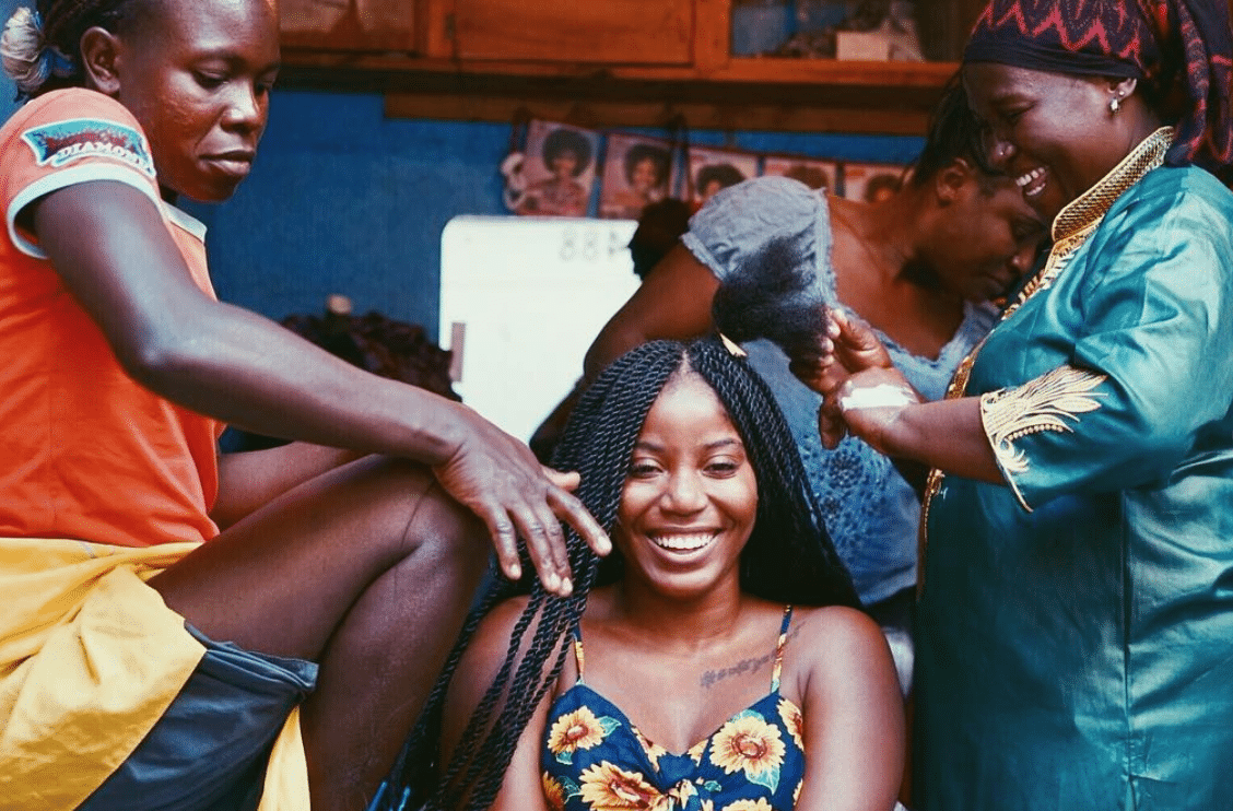 Black Travel Moment of the Day: This Happy Traveler Getting Her Hair Braided In Kenya Is Pure Black Girl Magic