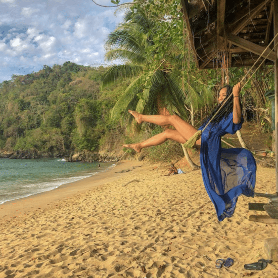 Black Travel Moment Of The Day: This Woman Happily Swinging On The Beach in Tobago Will Make Your Monday