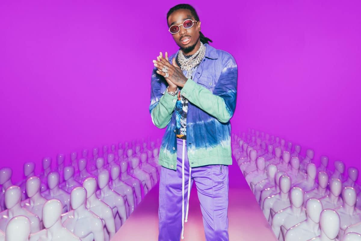 58491e70986 Migos star Quavo models a tie-dye denim jacket from his fashion design  collaboration with BoohooMAN. (Photo courtesy of BoohooMan.com) ...