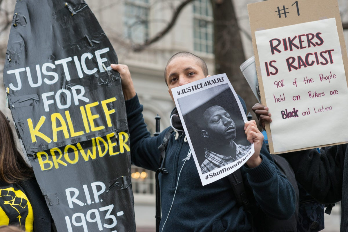 Protesters gather to rally against the treatment detainees face on Rikers Island, including solitary confinement