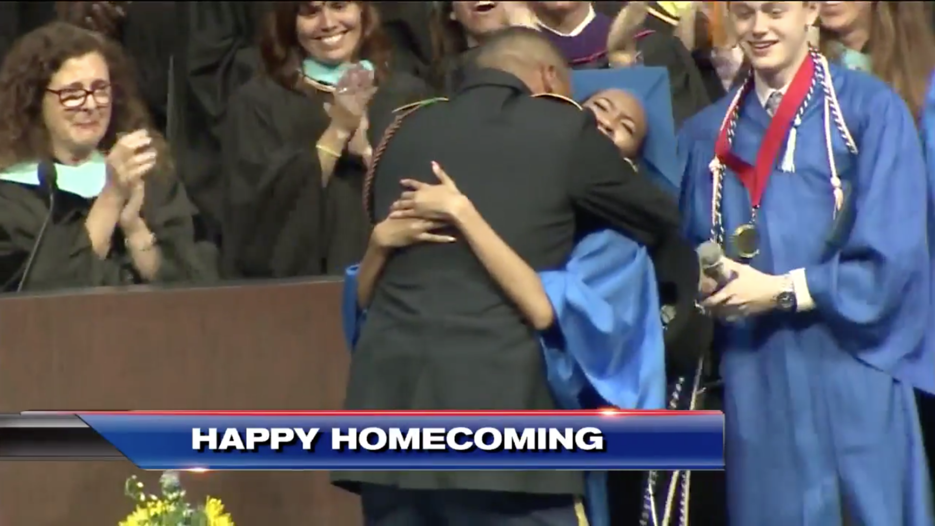 All The Feels: Deployed Soldier Surprises Daughter On Stage At High School Graduation