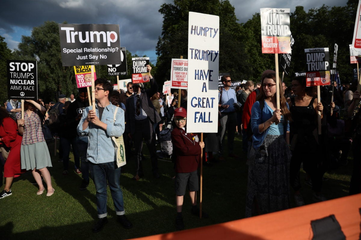 Protestors in London gather to disapprove of Trump's visit. He is often booed during appearances.