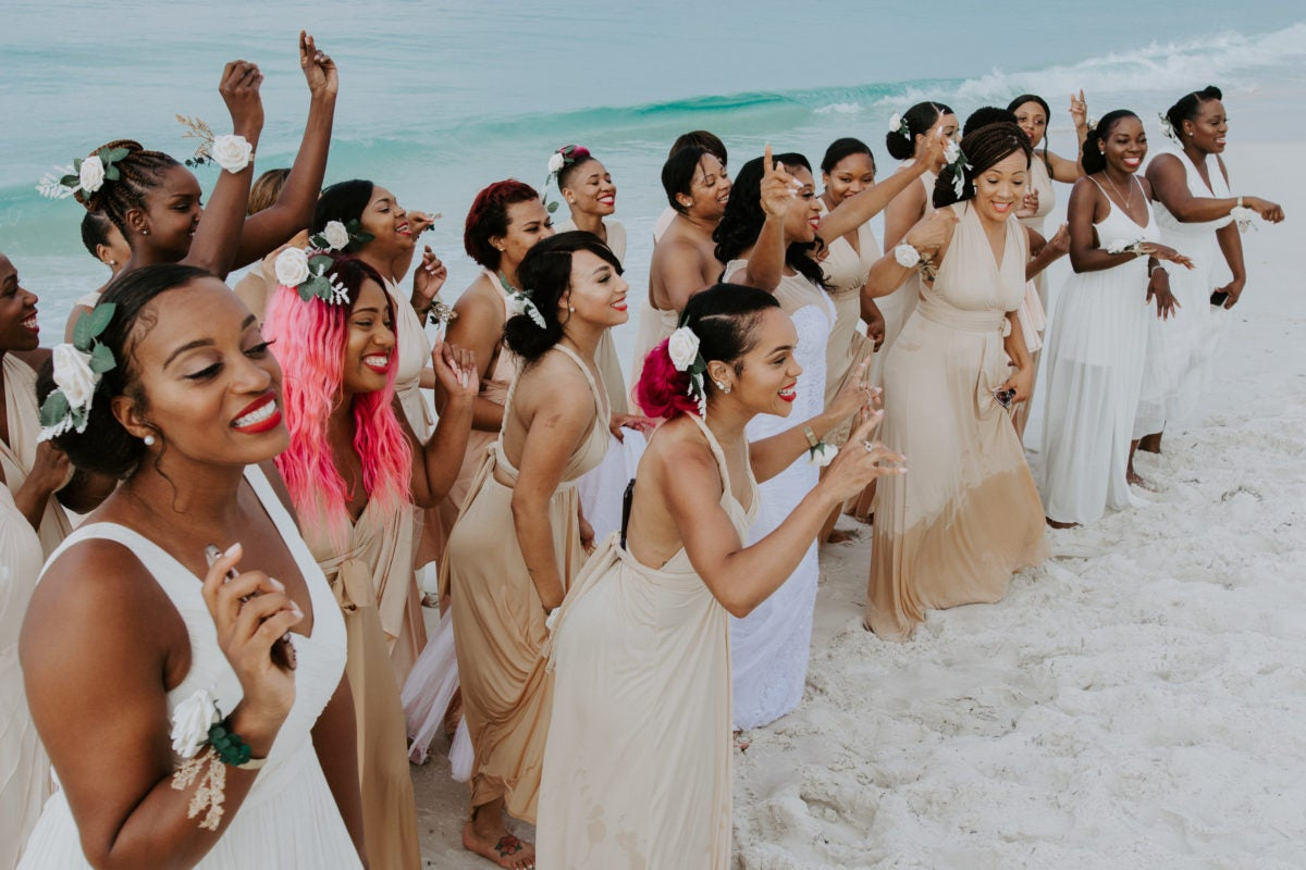 2aa96d6af ... the one thing they didn't have to worry about was finding enough folks  to join their bridal party. Seriously, they had enough ladies for three  weddings!