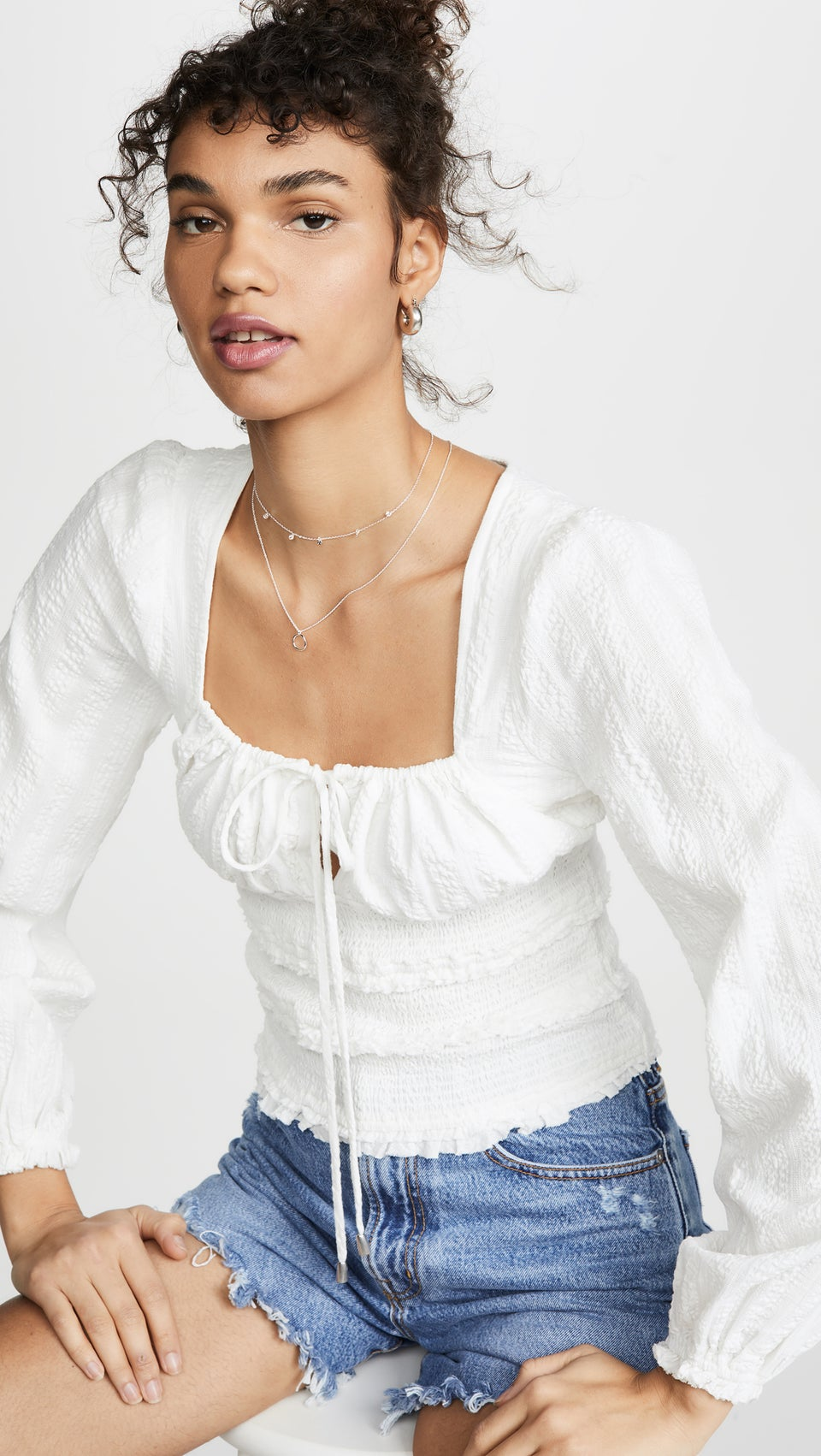 These White Statement Tops Deserve A Round Of Applause