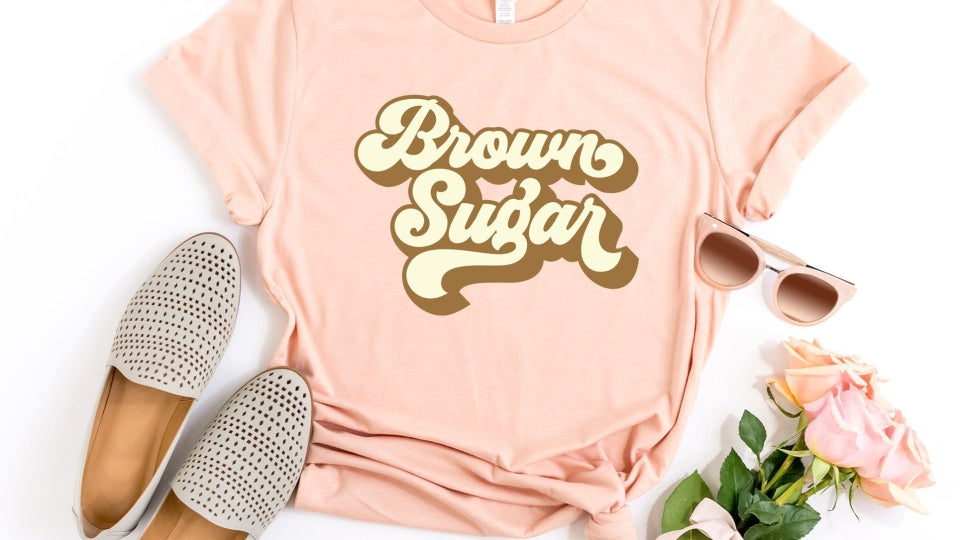 The 10 T-Shirts You Need to Celebrate Your Melanin At Essence Festival