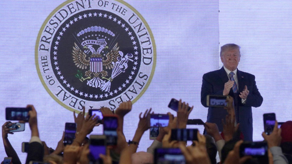 '45 Is A Puppet': Trump Appears On Turning Point USA Stage In Front Of Altered Presidential Seal