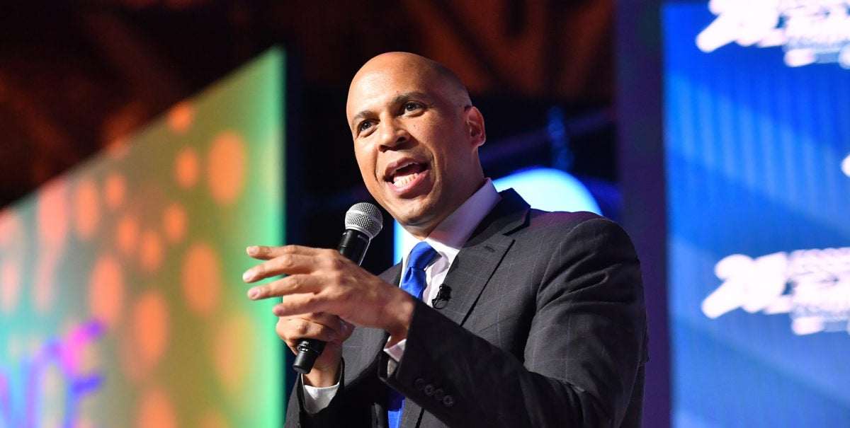 Cory Booker speaks to an audience at Essence Festival. The Senator is committing to a $100 billion plan for HBCUs