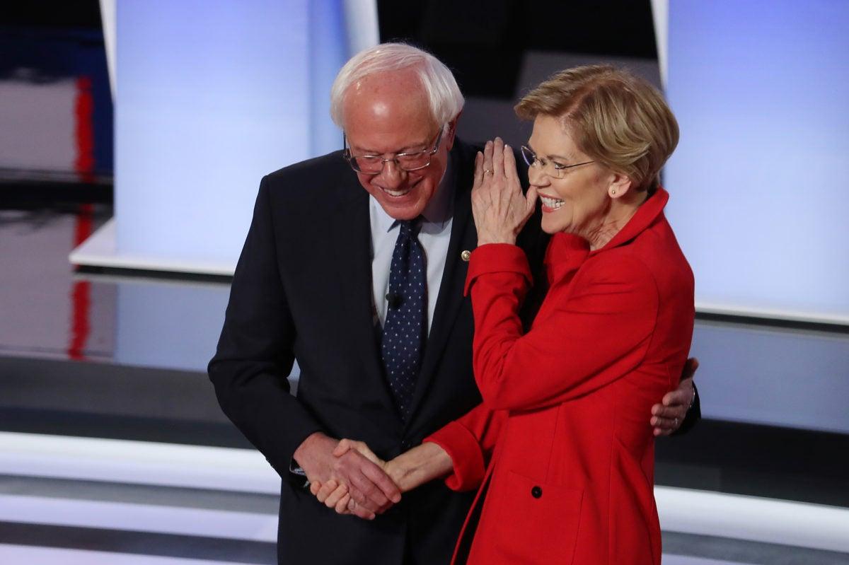 Senators Bernie Sanders and Elizabeth Warren shake hands ahead of presidential debate in Detroit
