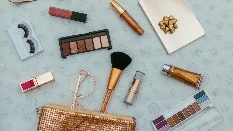 ESSENCE Staffers Share Their Beauty Travel Must-Haves For Festival