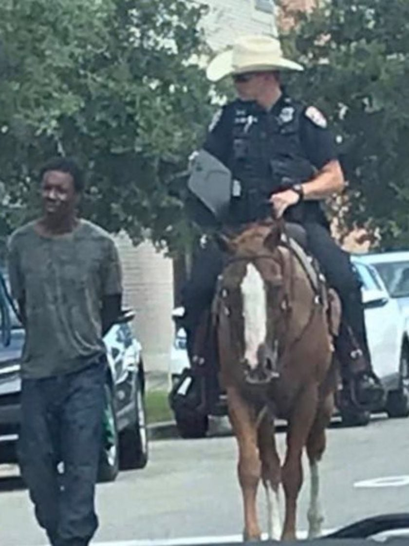 Texas Police Blasted After Mounted Officers Pictured Leading Black Man By Leash