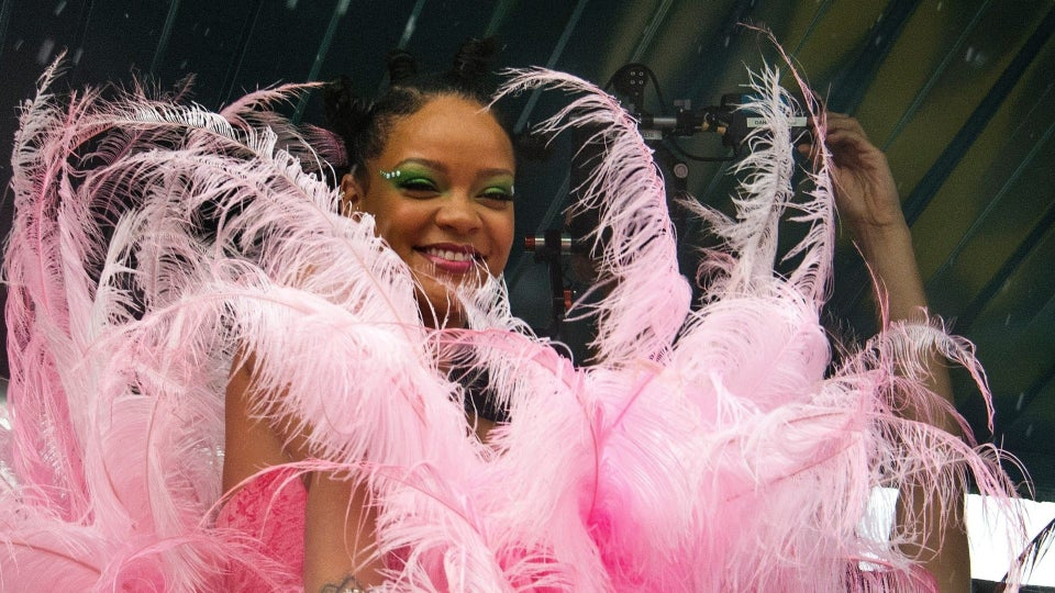 Rihanna Spotted in Massive Pink Feathers At Crop Over in Barbados