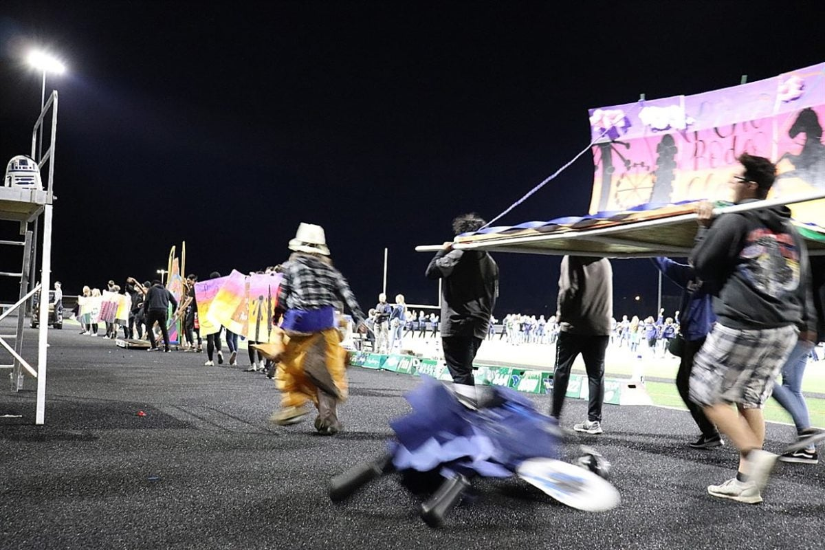 Students at Damonte Ranch high school are seen dragging a black mannequin from the back of a homecoming float.