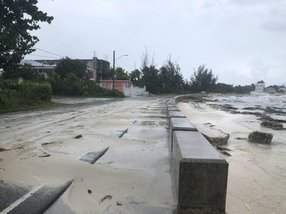 Sand pours on to a road near the beach during the approach of Hurricane Dorian on September 1,