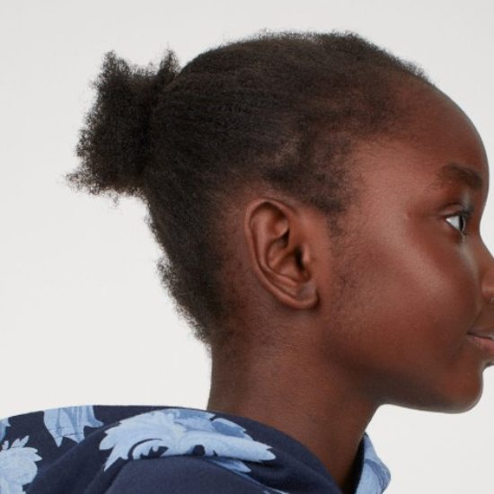 H&M Responds To Backlash Against Its Ad Of A Black Girl With 'Undone' Hair