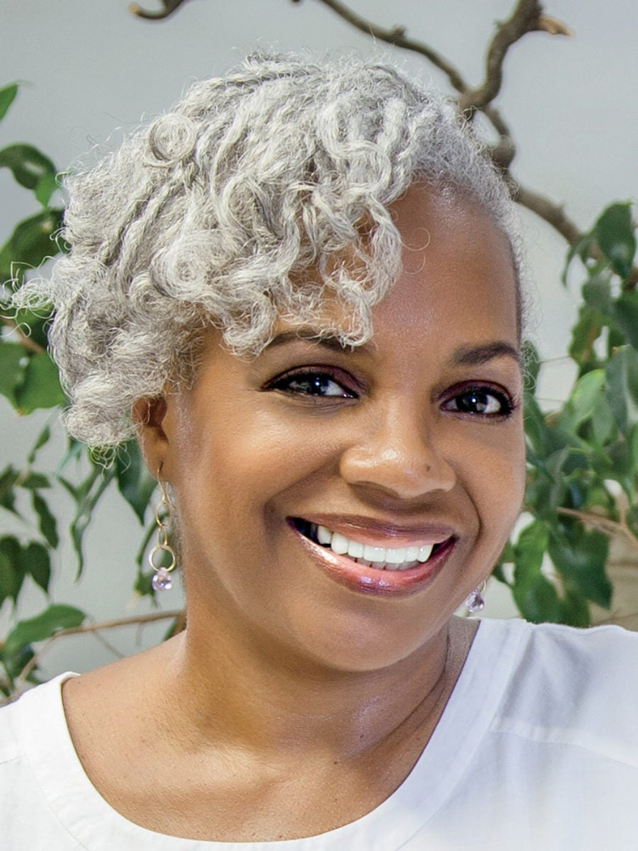 Headshot of Pamela Ferrell, who has built a profession doing natural hair braiding
