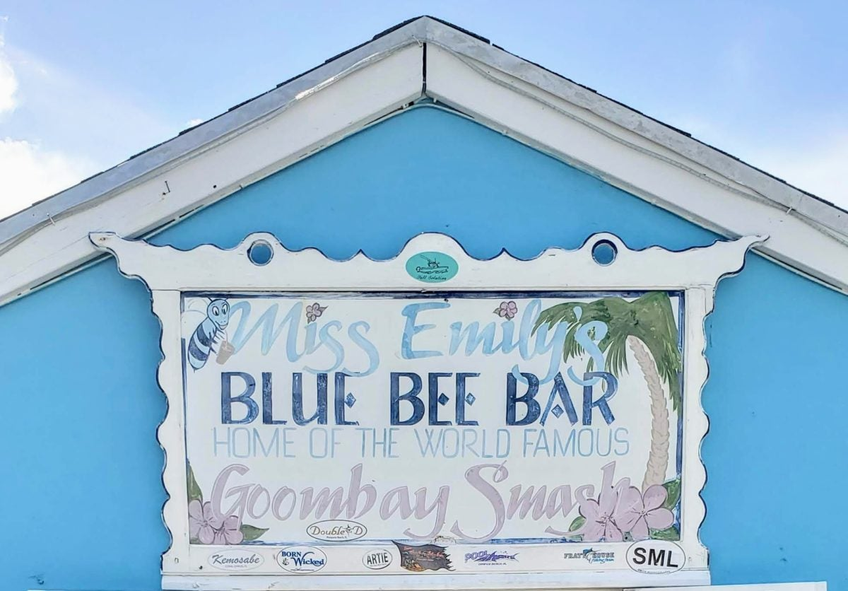 photo of blue roof with business sign reading: Miss Emily's Blue Bee Bar Home of The World Famous Goombay Smash