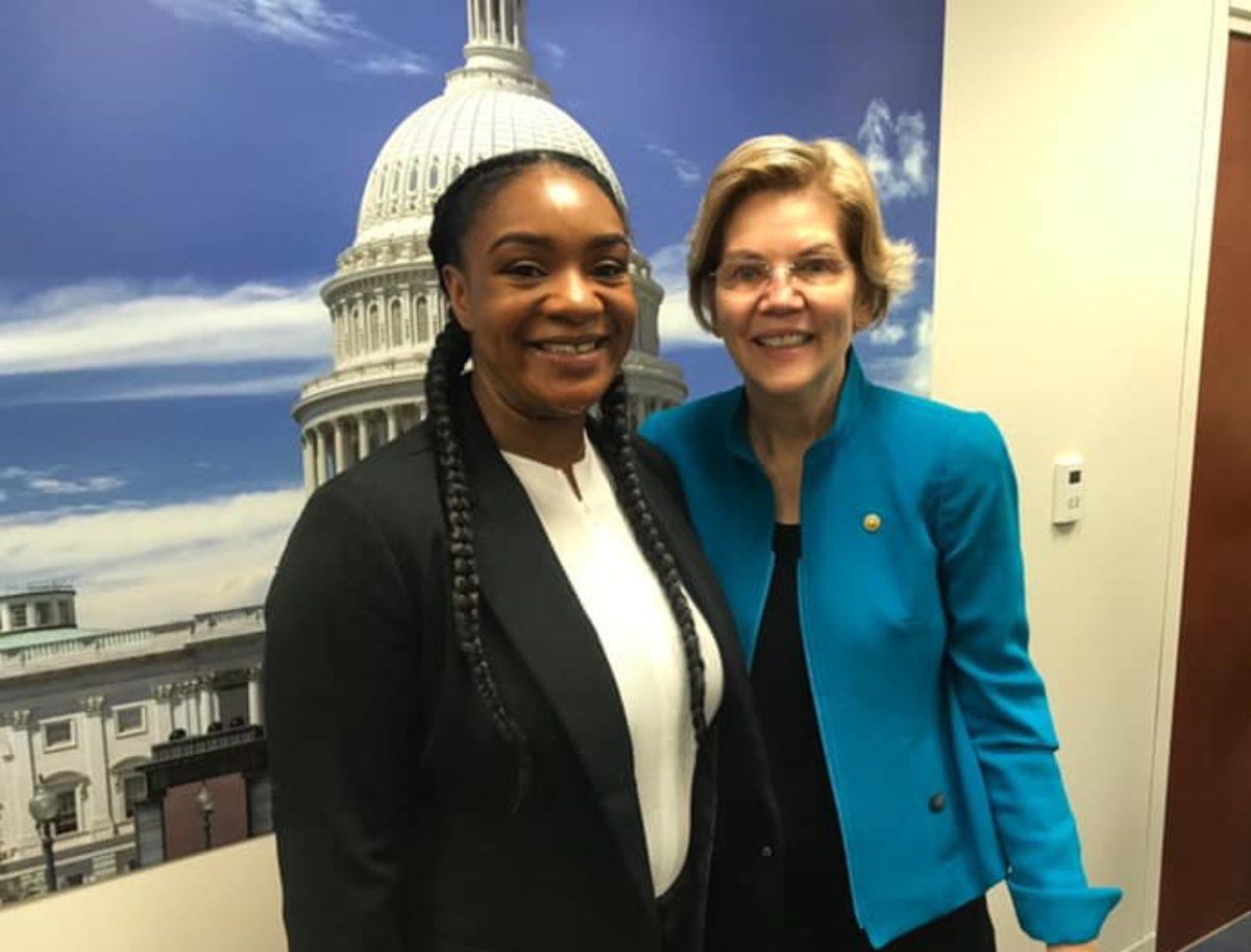 California resident Sasha Graham poses with Elizabeth Warren