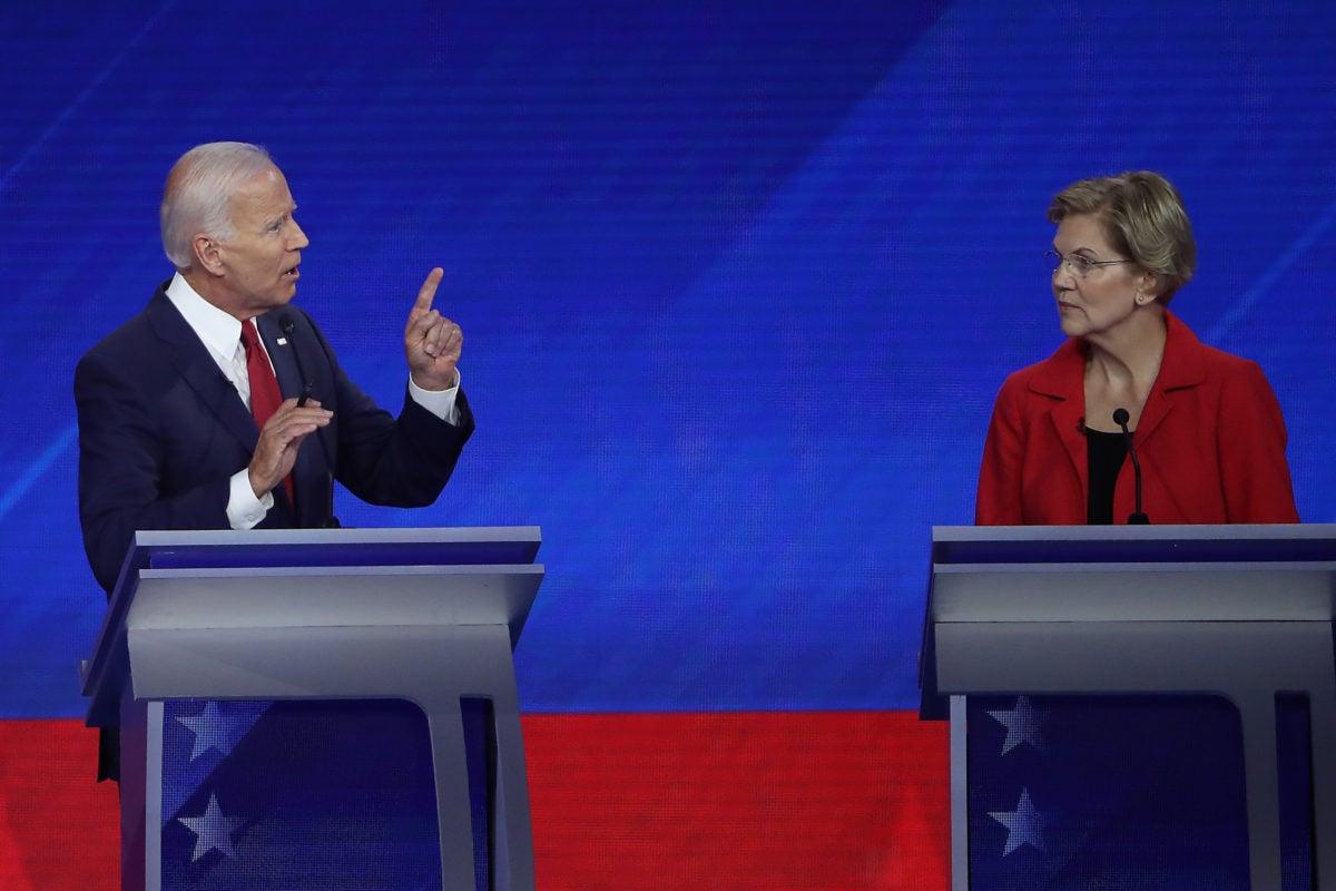 Frontrunner Elizabeth Warren, looks over at Joe Biden during a debate