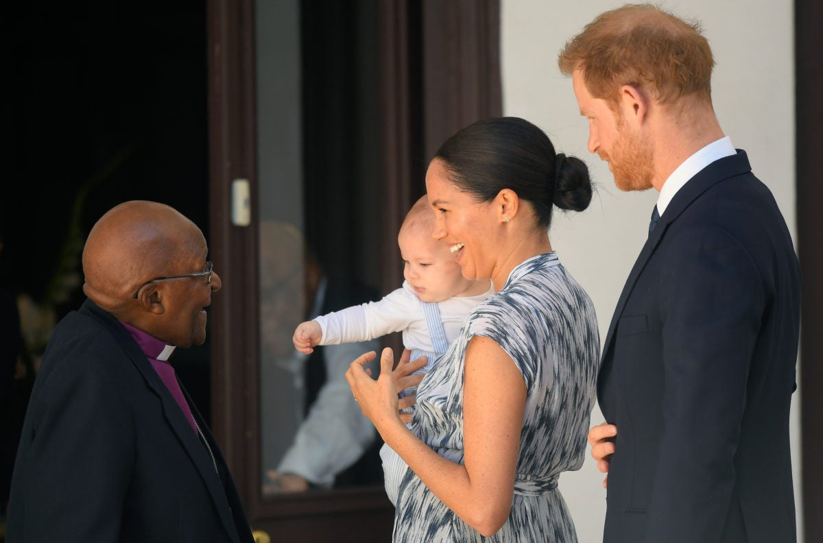 Prince Harry and Meghan Markle greet Desmond Tutu who helped make Ubuntu popular