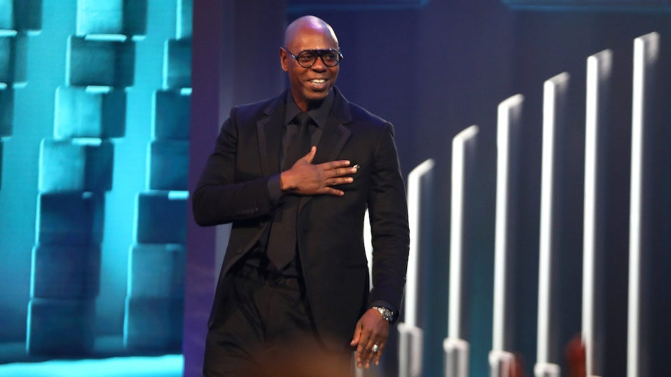 Dave Chappelle Claps Back At Critics And Honors Stan Lathan After Winning Three Emmys For 'Sticks And Stones'
