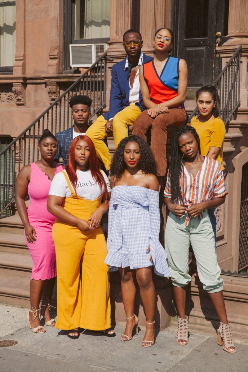 CultureCon team of Black creatives gathers in front of a Harlem brownstone