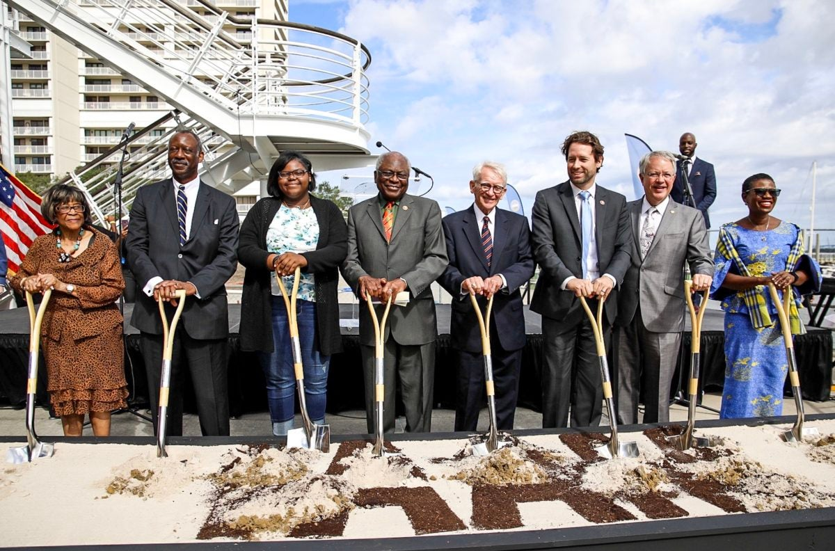 Congressman Jim Clyburn joins a local studentCongressman Jim Clyburn (D-SC), Congressman Joe Cunningham (D-SC), Governor Henry McMaster (R-SC), Mayor John Tecklenburg (Charleston, SC), former Charleston mayor Joe Riley, and Mayor Yvonne Aki-Sawyerr (Freetown, Sierra Leone) at the groundbreaking of IAAM