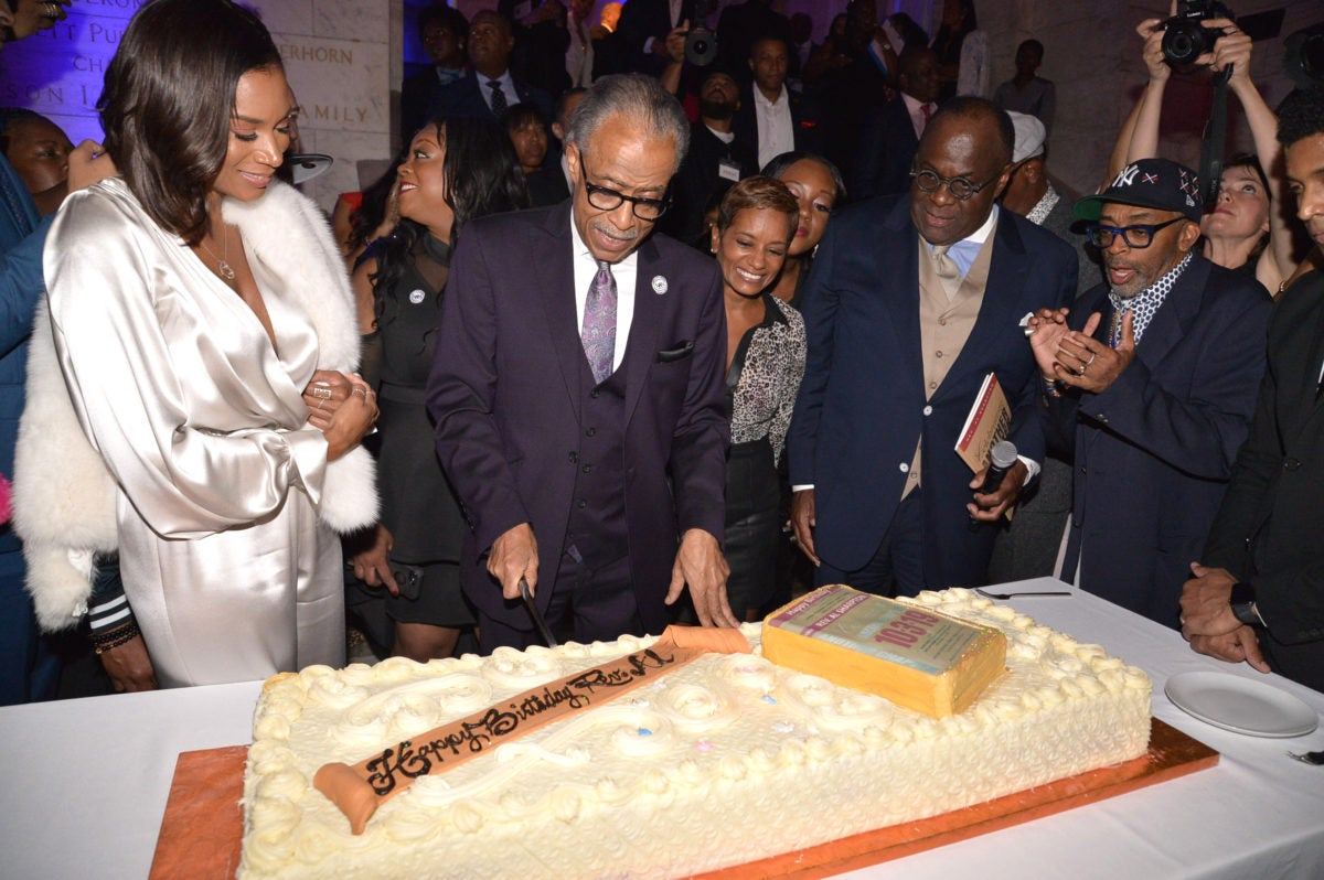Rev. Al Sharpton cuts into his birthday cake