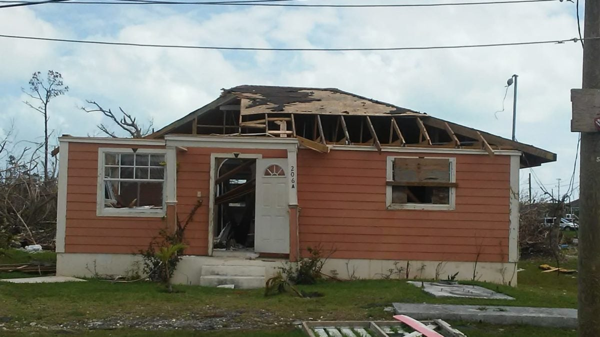 Exterior of home in Abaco, Bahamas showing roof off and other structural damage
