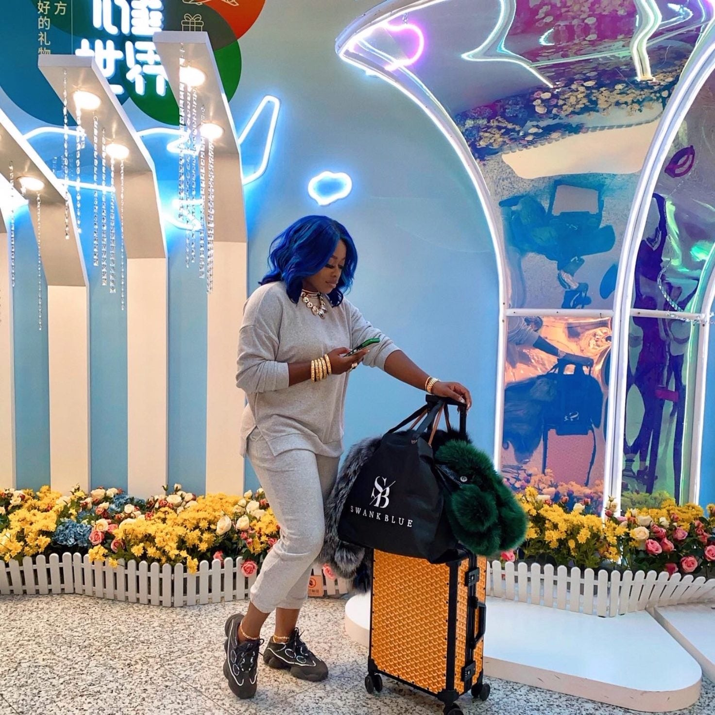 Stylist Olori Swank Dishes On What's In Her Carry-On Bag