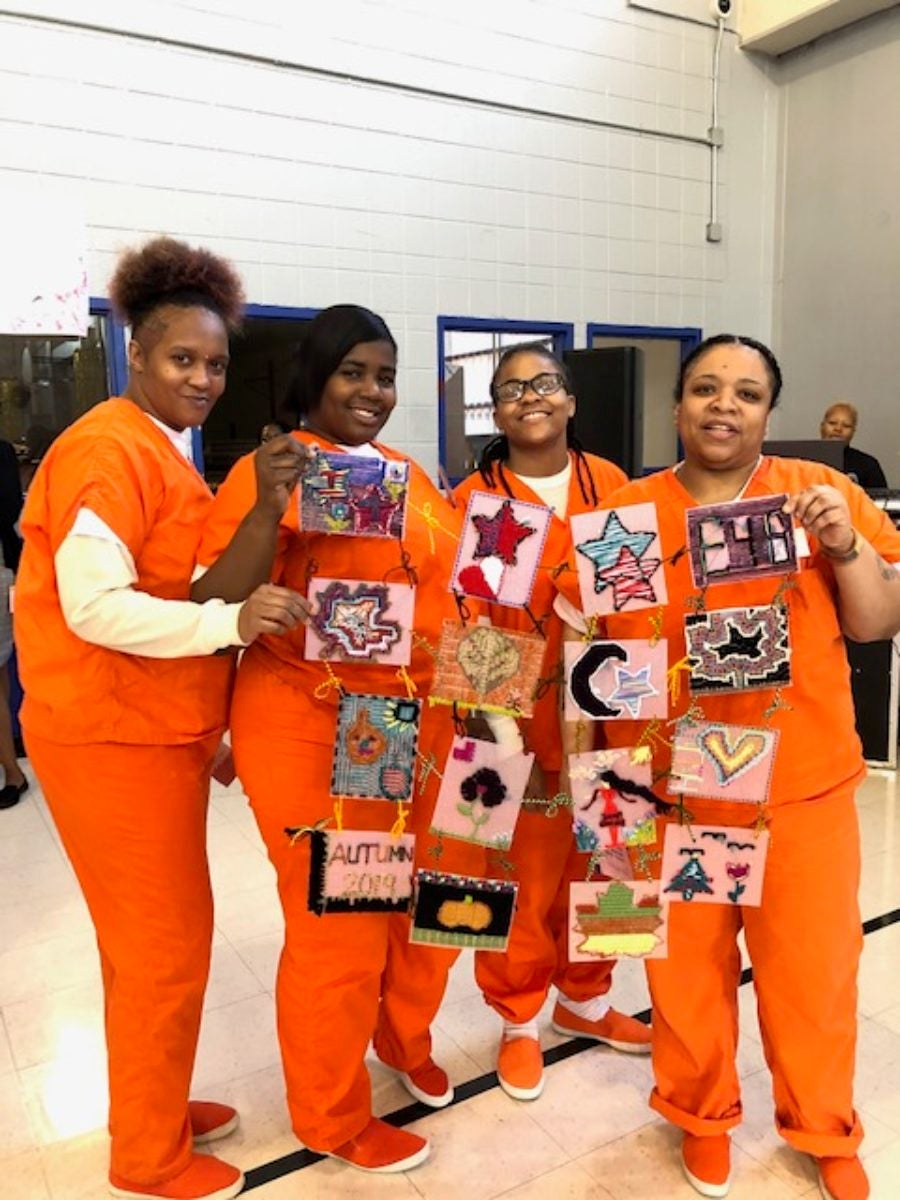 Some of the women at the DCDOC's empowerment event show off their embroidery
