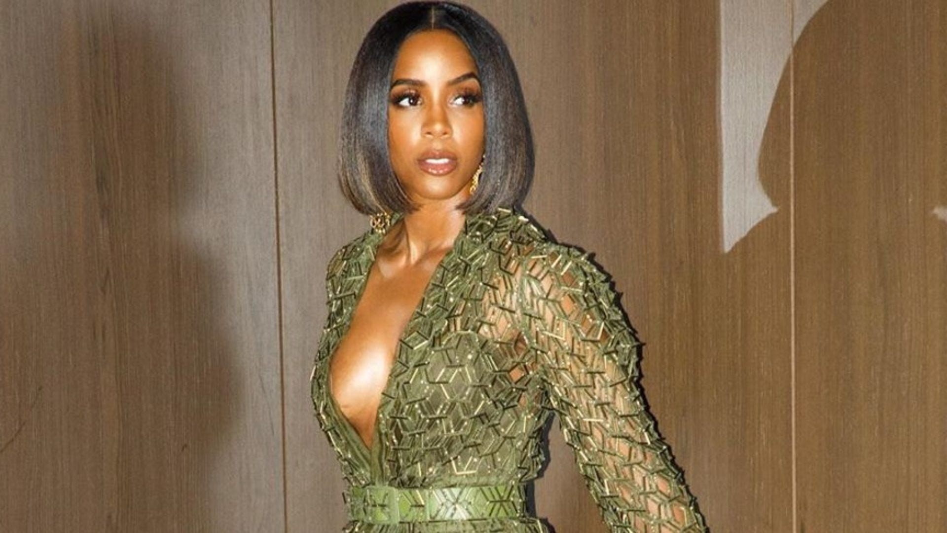 Kelly Rowland Glistens In A Laser Cut Blazer and Skirt