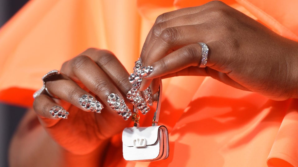 Lizzo Wore This Tiny Accessory On The AMA Red Carpet