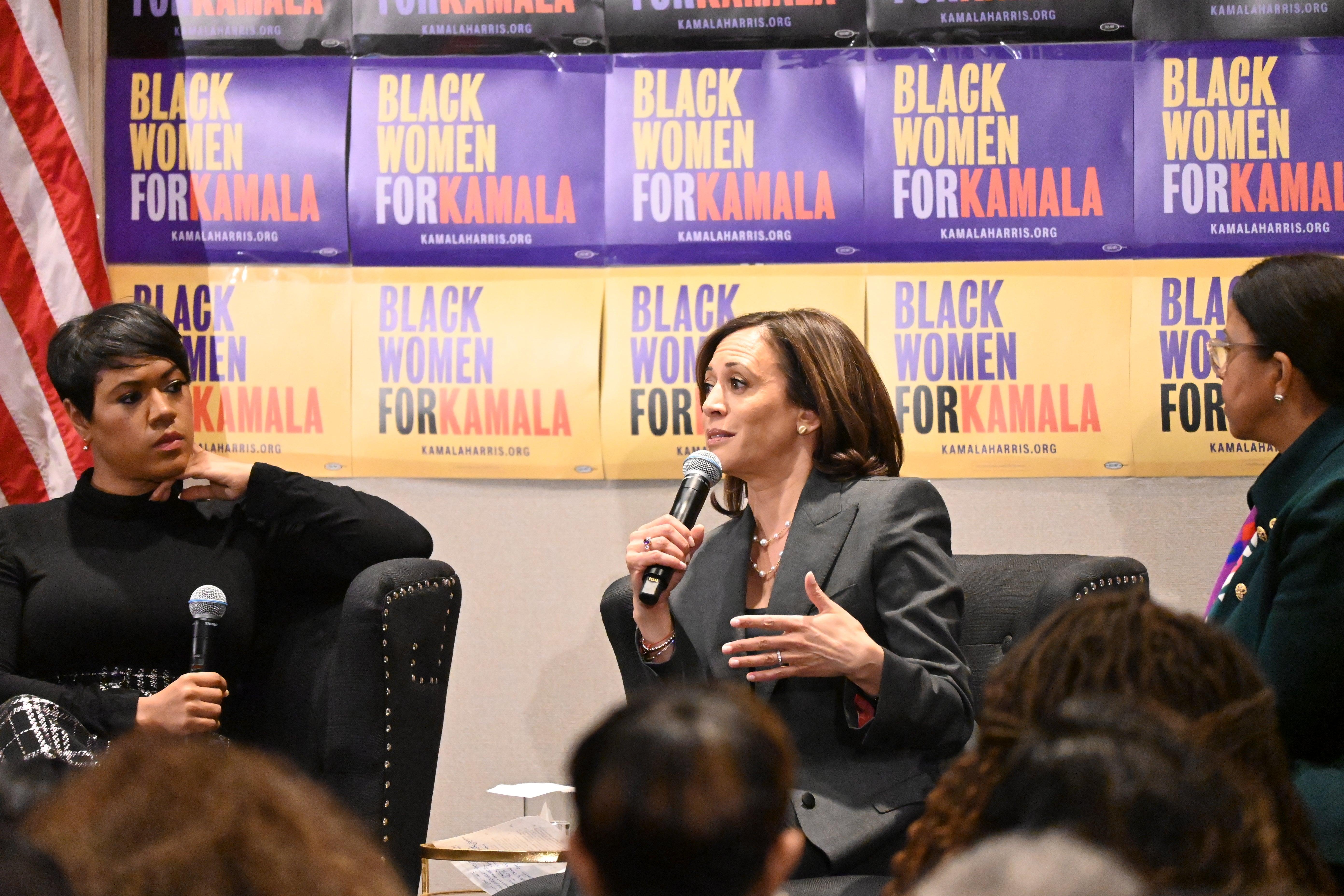 Sen. Kamala Harris speaks with Tiffany D. Cross at a Black Women's Power Breakfast in Atlanta, the day after the November Democratic primary debate.