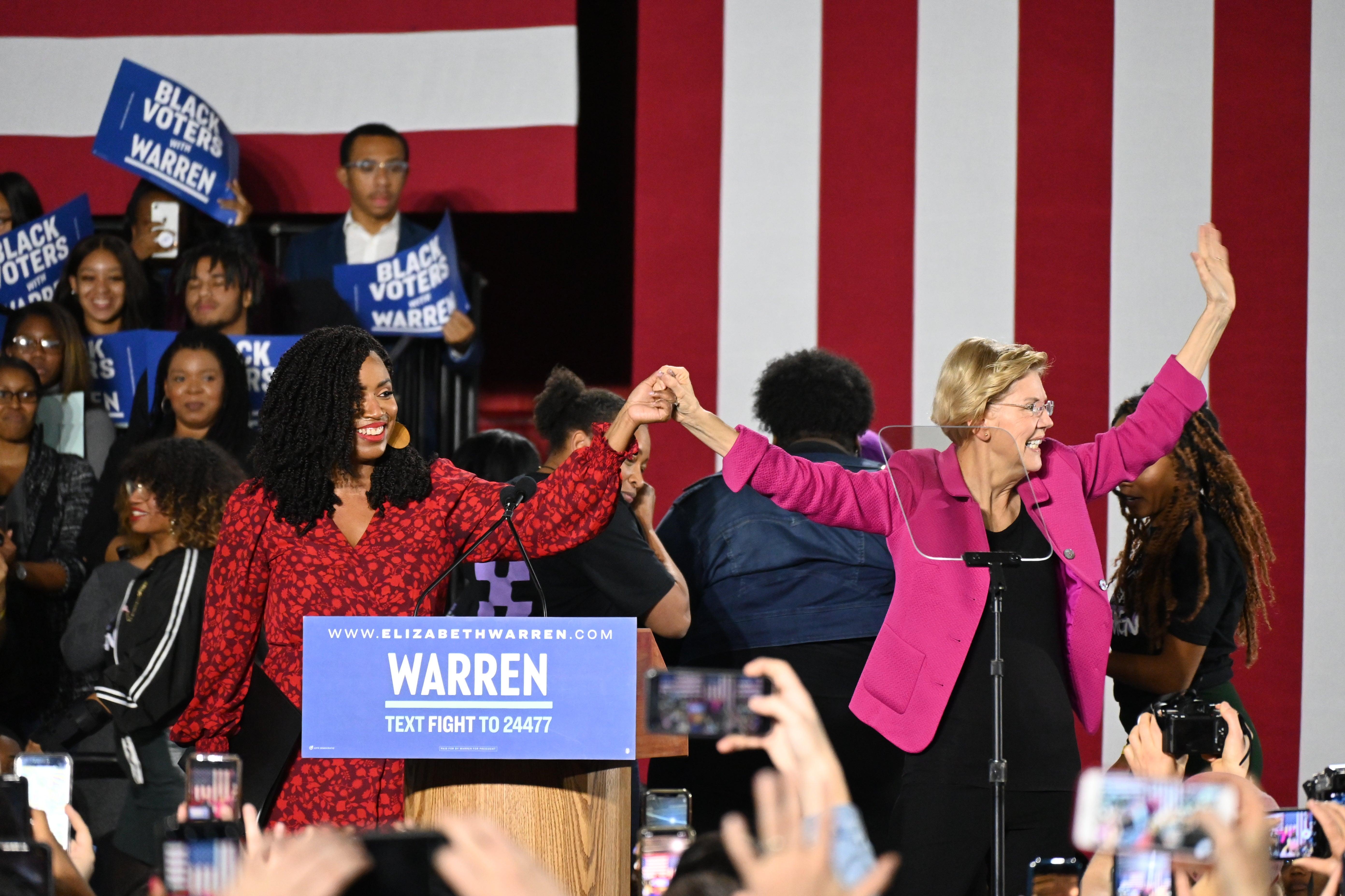 Congresswoman Ayanna Pressley joins Sen. Elizabeth Warren on stage at Clark Atlanta University.