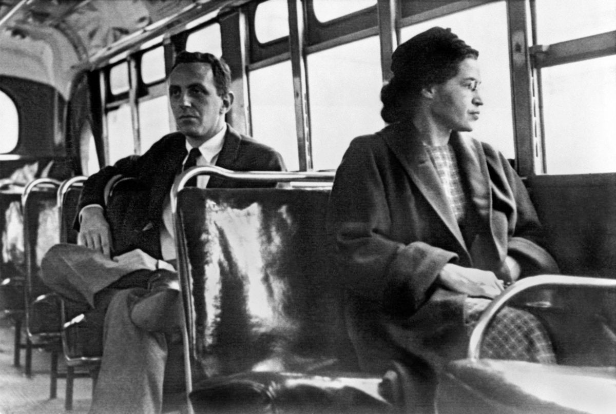 Rosa Parks on a bus. Milwaukee now honors her legacy on their fleet of buses.