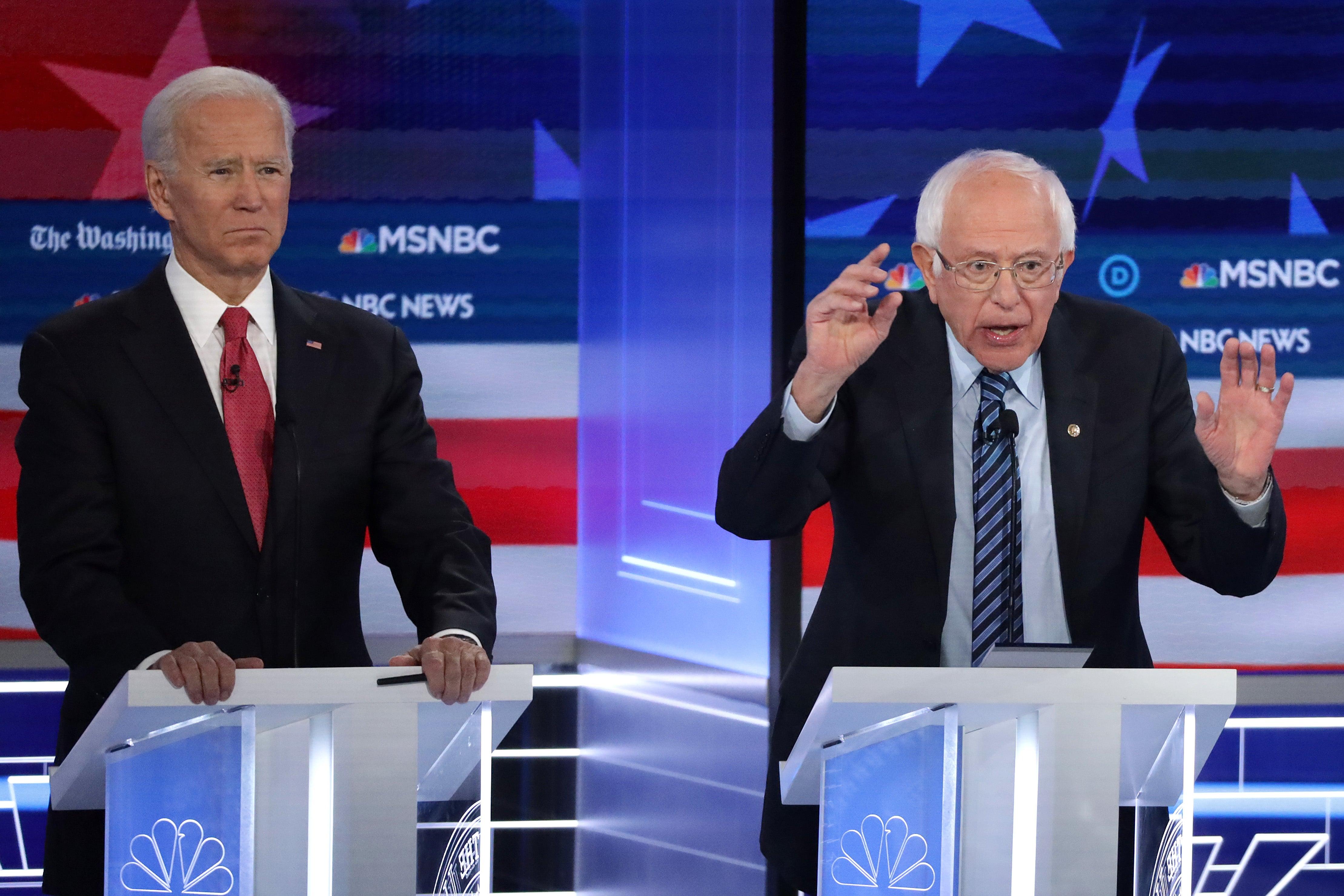 Joe Biden and Bernie Sanders discussing pressing matters like Social Security at November debate