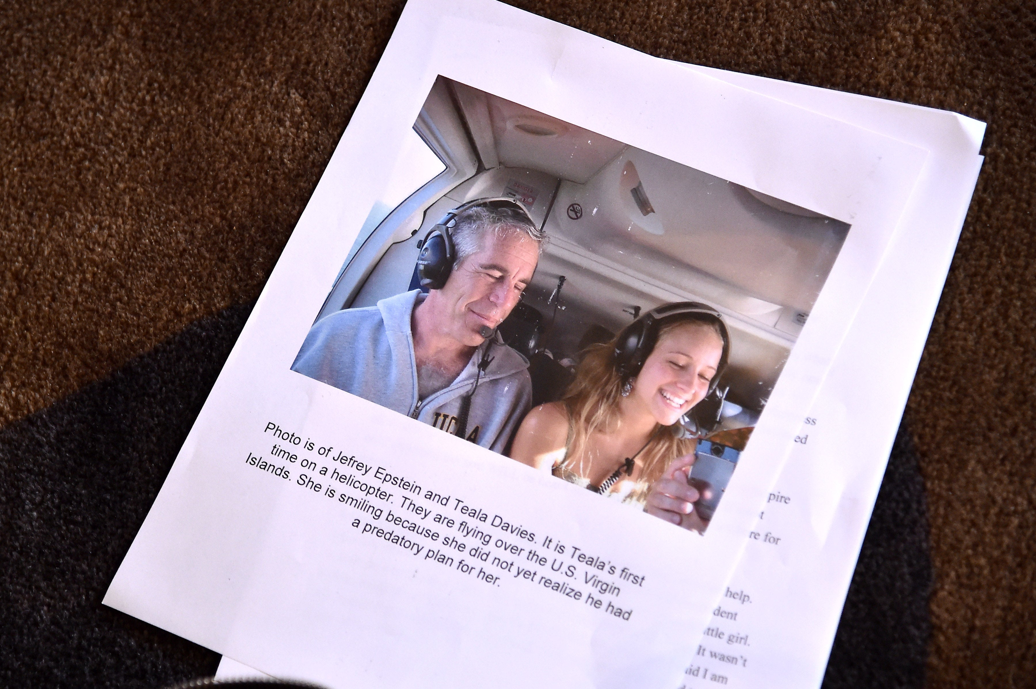Photo of Jeffrey Epstein with a young woman. Epstein's estate is now being sued.