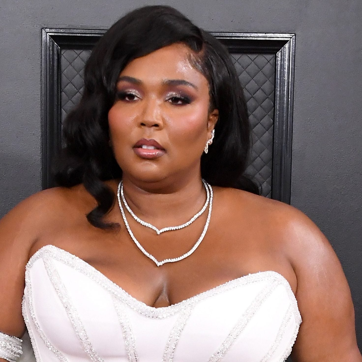 Lizzo Sports Sleek Versace Gown On The Grammy's Red Carpet