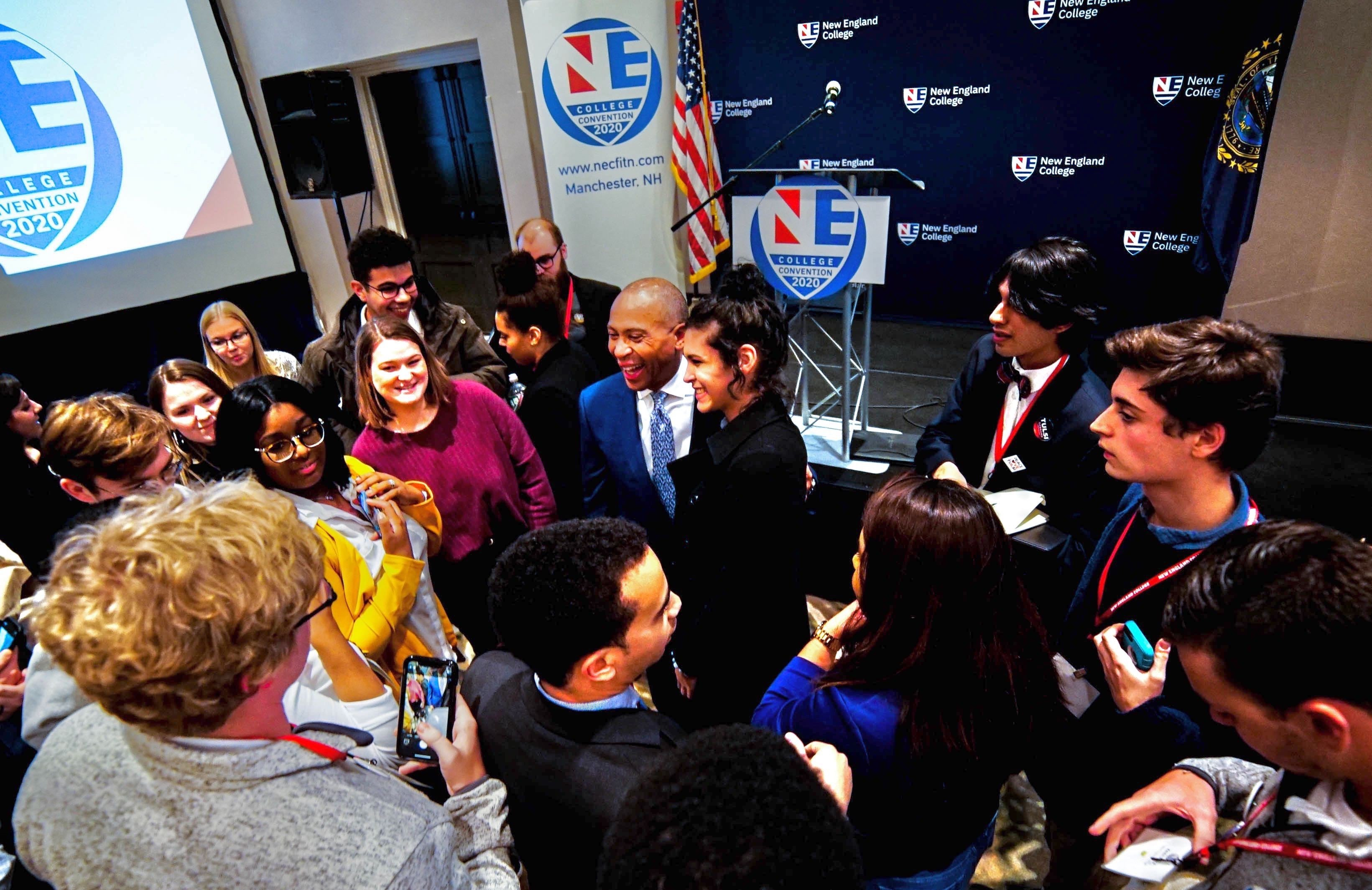 Deval Patrick greets attendees at the NE College Convention in Manchester, New Hampshire.