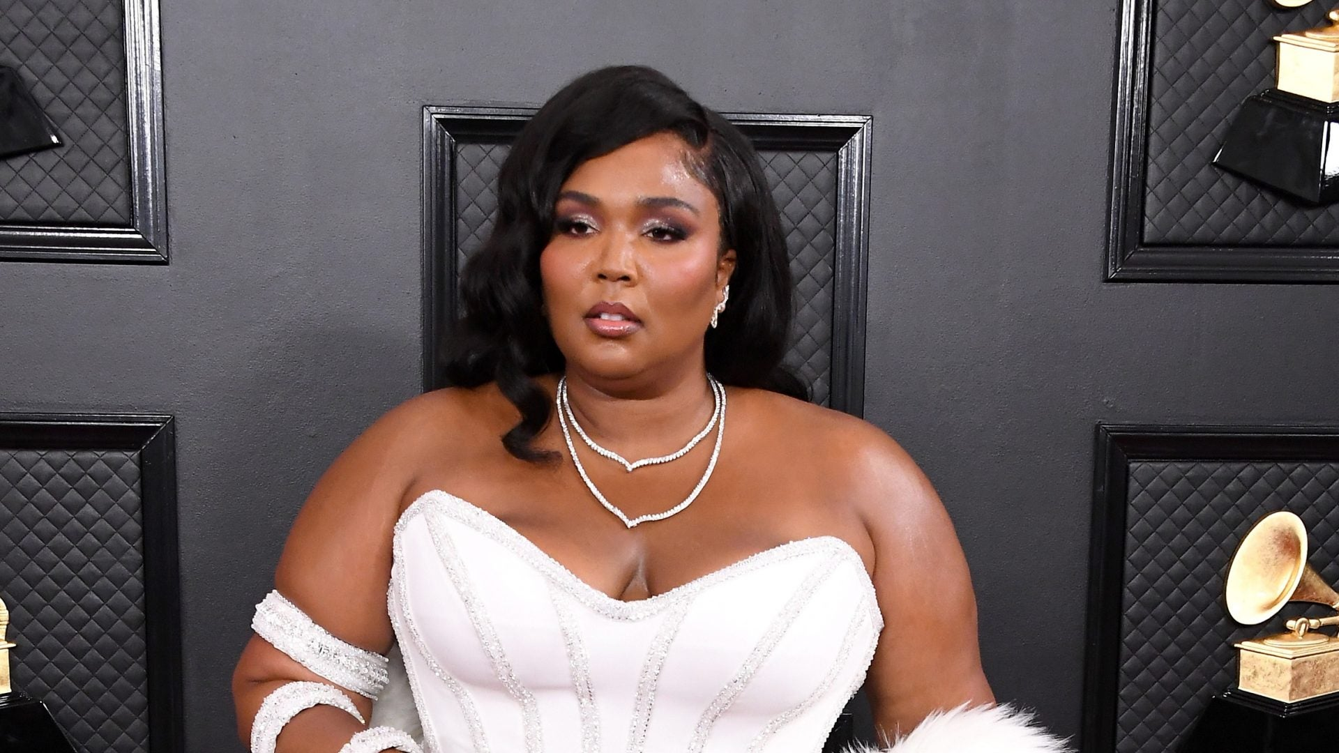 Lizzo Sports Sleek Versace Gown On The Grammys Red Carpet