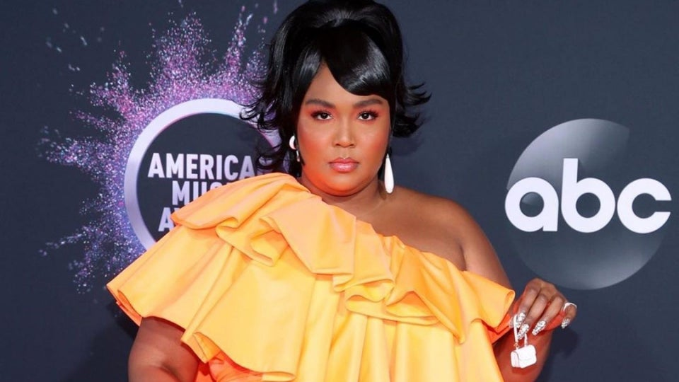 Lizzo Finally Reveals What She Carries In Her Tiny Bag