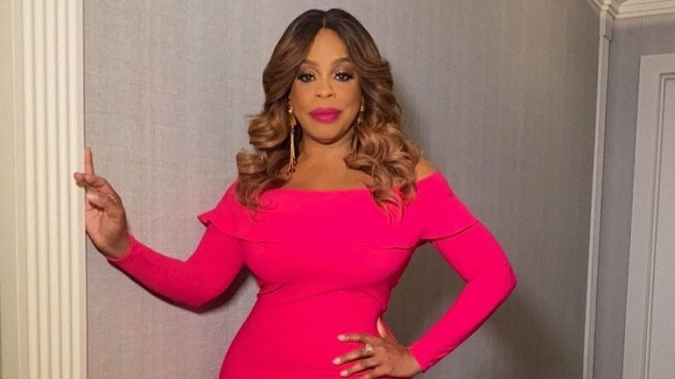 Niecy Nash's Hot Pink Dress Is The Perfect Pop Of Color