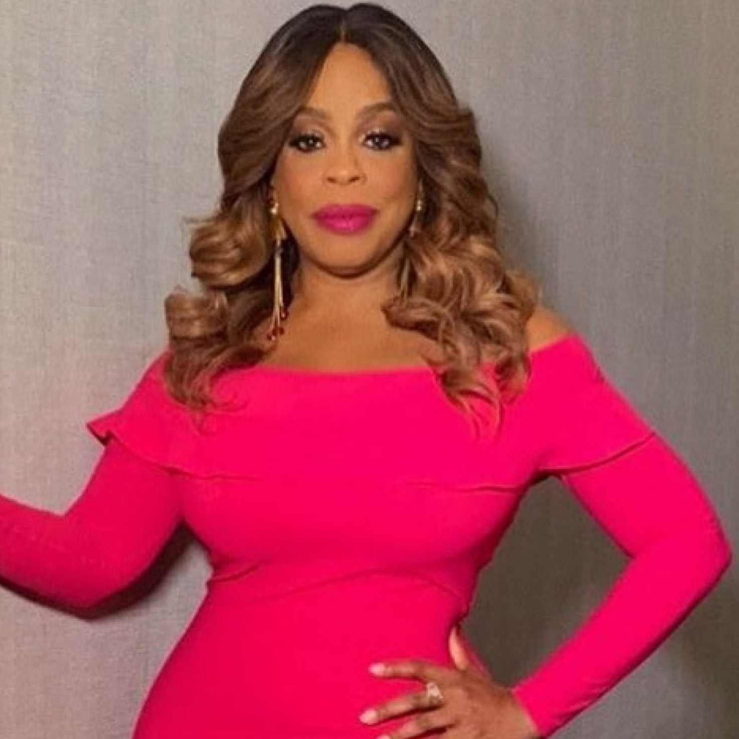 Niecy Nash's Hot Pink Dress Is The Perfect Pop Of Color This Season