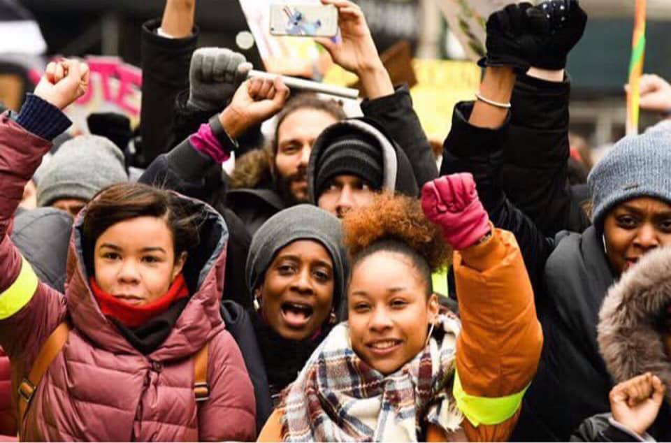 Cidra Sebastien with students at a rally in New York City.