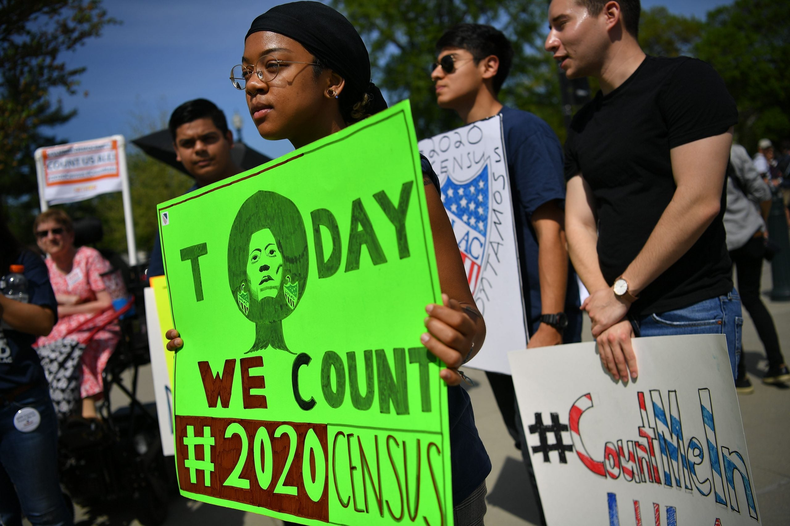 "Young, Black girl holds ""Today We Count"" poster at census rally"