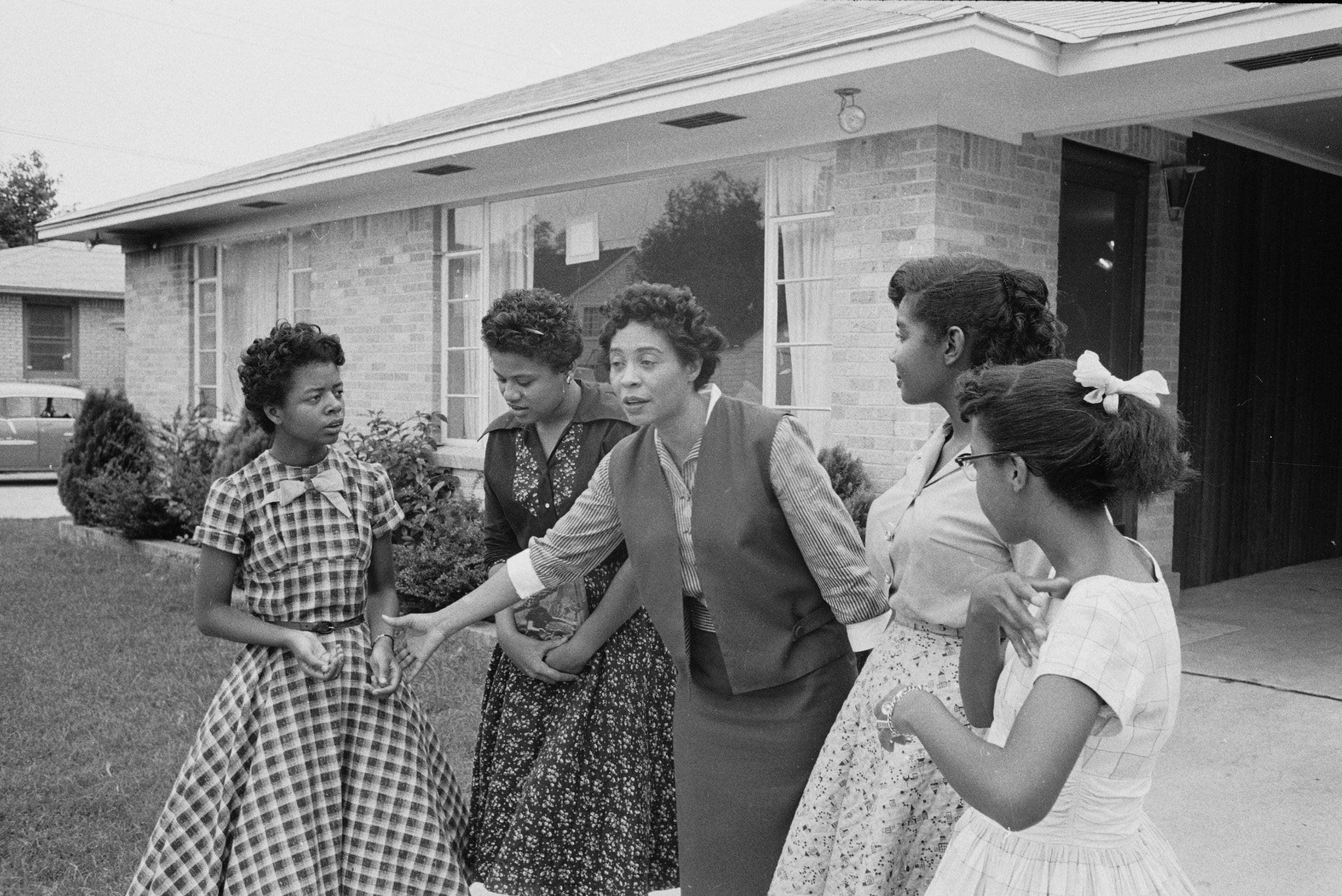 Daisy Bates stands with four African-American students in front of her home in Little Rock, Arkansas,