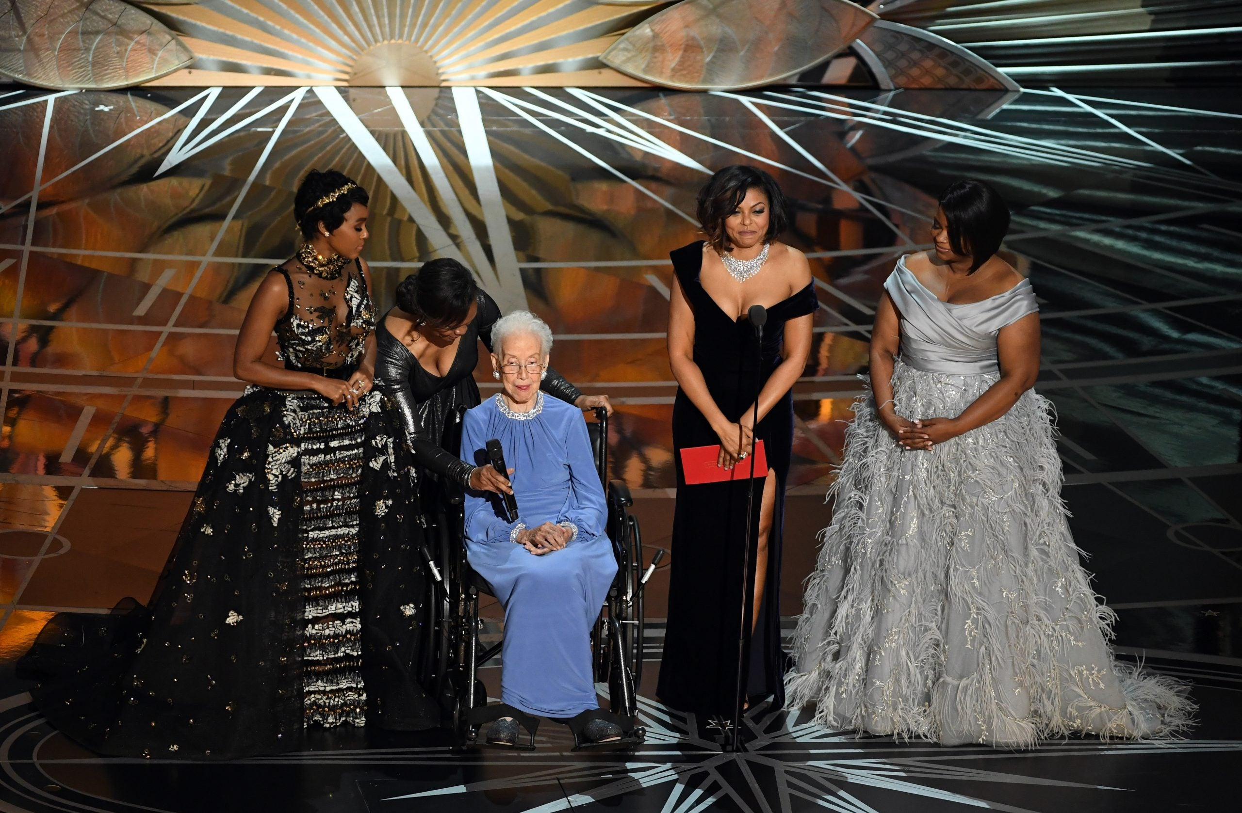NASA mathematician Katherine Johnson (2nd L) appears onstage with (L-R) actors Janelle Monae, Taraji P. Henson and Octavia Spencer speak onstage during the 89th Annual Academy Awards