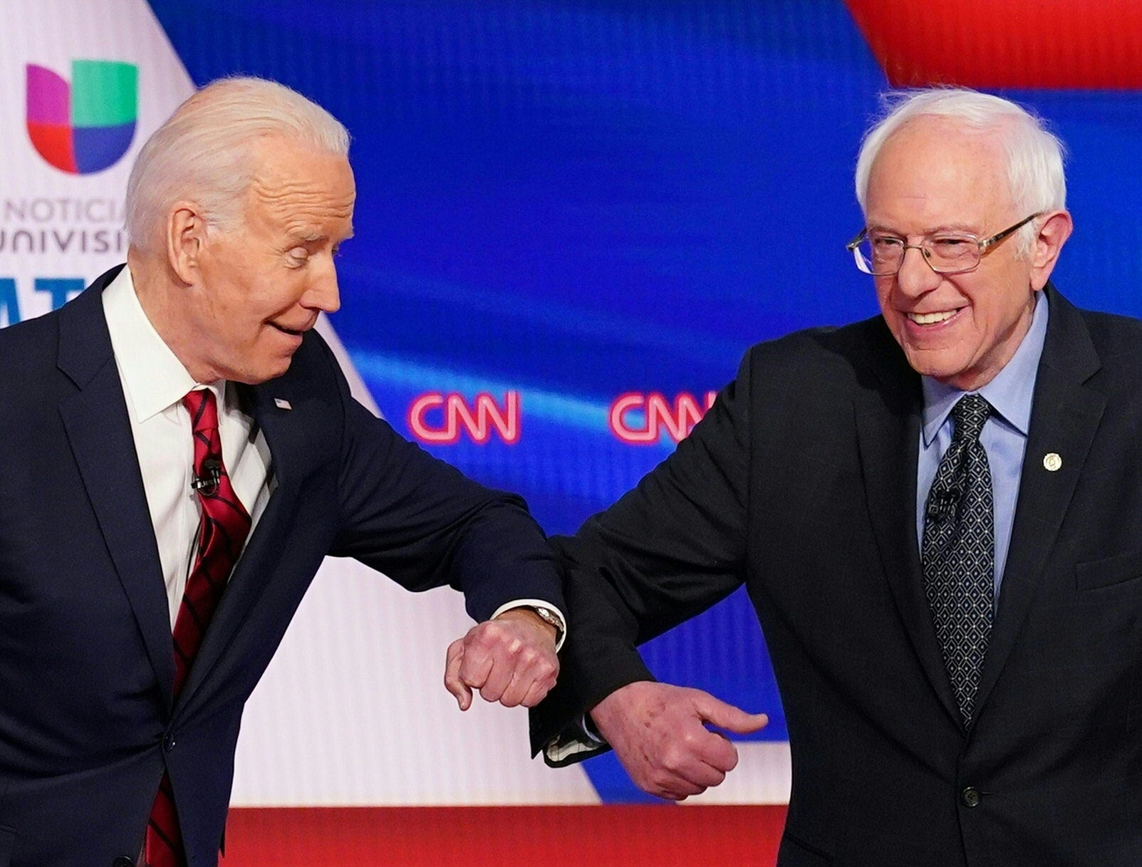 Biden and Sanders greet one another with elbow bumps during debate. The April debate is still TBD